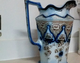 Flow blue and brown transferware pitcher.
