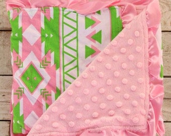 Green and pink rose baby girl receiving blanquet