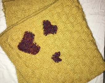 Handknit yellow baby blanket with hearts