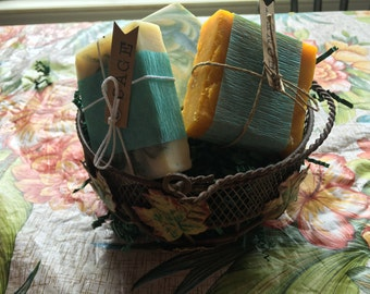 three soaps of choice in a decorative metal basket