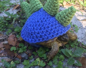 Stegosaurus tortoise topper. Hand made to order, any size or color. Contact me with your torts shell size.