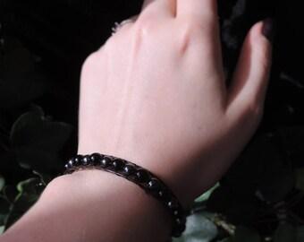 Wrap onyx, leather and hematite bracelet