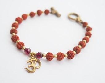 Rudraksha bracelet with OM sign and garnet gemstones