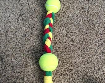 Dog tug toy with 2 balls.