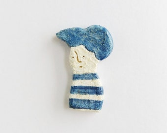 And the uebi clay brooch