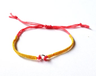 Macramé bracelet yellow and coral with small ring