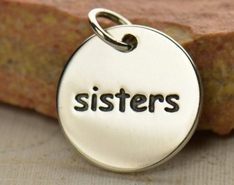 Sisters charm. Sterling silver disc. Family jewelry add to your charm bracelet.