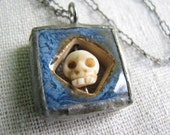 Tiny skull and ceramic necklace