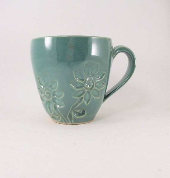 handmade green mug with stamped flowers