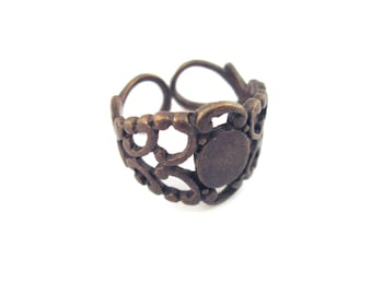 10 brass filigree rings, with a 6x8mm glue on pad