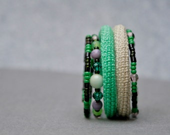 crochet wrap bracelet with glass beads in green and natural white