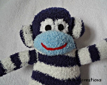 Isaac the sock monkey ready to ship blue and white