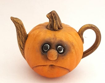 1:12 scale fantasy pumpkin with face teapot.
