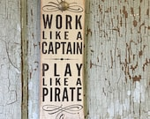 Work Like a Captain-Play Like a Pirate sign from reclaimed materials by Old Barn Rescue Company