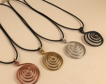 Small Spiral Necklaces in Silver, Copper, Brass (Gold), and Black