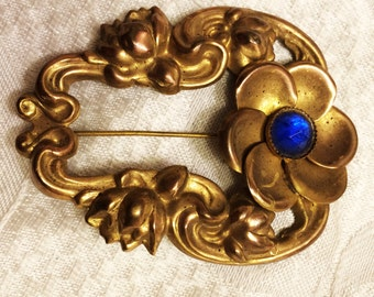 Vintage Antique Art Nouveau Flower Sash Pin Brooch with Blue StarCut  Glass Stone Set in Brass Measures 2 5/8 by 2 Inches (J129)