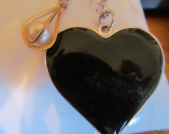 black heart with caged pearl necklaces