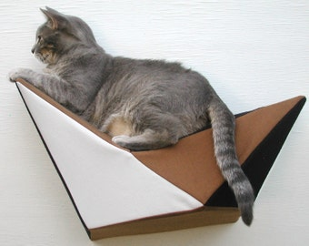 Cat shelf wall bed in brown, black and white
