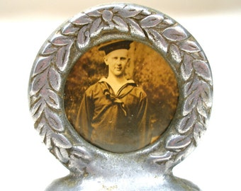 50s UK aluminum frame, Aluminum wreath frame with sailor, made in England