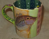Bold pattern and great colors on mug with wise fish