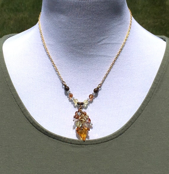 Yellow Crystal Heart with Crystal dangle pendant. Polished brass chain