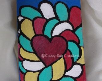 Happy love heart painting on repurposed pressed chipboard