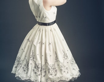 Fifties style tea length dress in white cotton with black embroidery and tulle petticoat