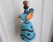 Whimsical clay handbuilt turquoise wind chime with bird