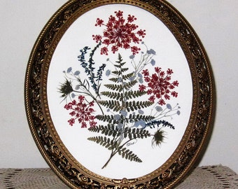 pressed flowers and fern in 8x10 goldr oval frame