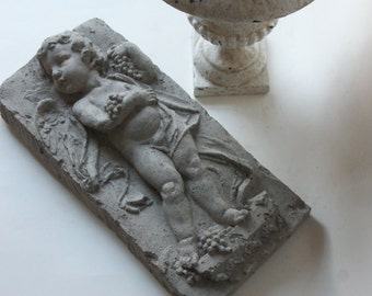 cement cherub with grapes tile