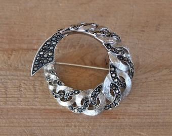 Avon of Belleville brooch / designed by Marcel Boucher / marcasite and silvertone metal circular brooch