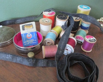 Wood Spools, Brass Thimble, Needle Pack, Pincushion Box, and Fabric Measuring Tape