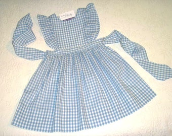 Easy Care Gingham in Pinafore Jumper style.  Sizes 12 months to 5.  Choice of colors.