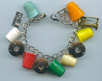Sewing Theme Charm Bracelet With Vintage Thimbles Bobbins and Charms