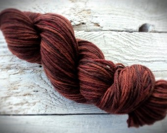 Hand painted yarn - hand dyed wool yarn - worsted weight - rust brown - knit