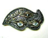 Black and bronze leather hair barrette with Evil Eye.