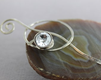 Penannular German silver shawl pin or scarf pin with a wrapped clear crystal-like button