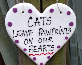 Cats leave pawprints on our hearts ceramic hanging plaque