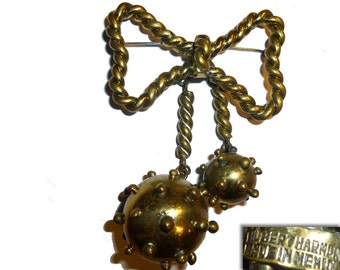 "Rare Hubert Harmon Spiked Brass ""Sputnik"" Naval Mine Brooch. Iconic Bow with Dangles Pin. Signed. Vintage 1940s Taxco Mexico."