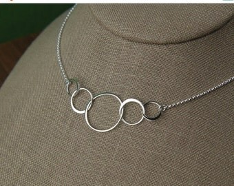 SALE 15% OFF Five linked circles necklace in sterling silver, five entwined circles, interlocking circles, family necklace