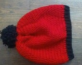 red and black curly pom pom slouch hat