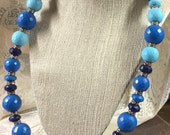 large faceted lucite bead necklace with rhinestone rondelles and pave rhinestone clasp