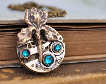 ANTIQUE IRIS,  antiqued flower steampunk watch movement necklace in antiqued brass