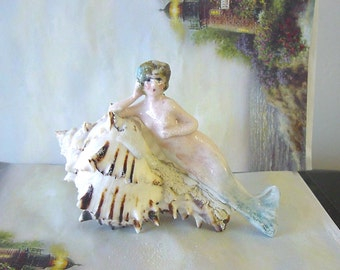 Mermaid resting in a Natural Seashell