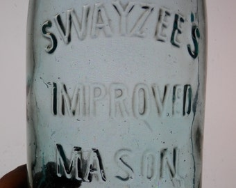 1 antique Swayzee's improved mason jar qt size with zinc lid with brown streak in glass