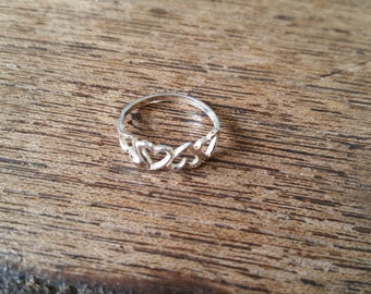 Small four hearts sterling silver ring, size 6