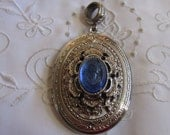 Vintage Silver Tone Large Oval Locket Pendant with Raised Blue Glass Cameo and Fancy Etching with Flowers