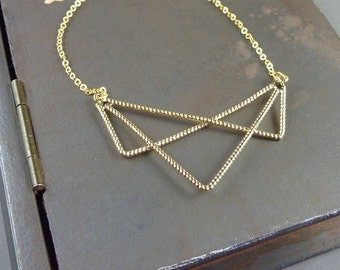 Modern Geometric Statement Necklace. 14k yellow gold plated. modern. geometric. statement.