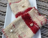 A pair of 5 inch short wrist warmers, hand knitted from handspun merino, small  size in pink, Scarlett and cream with scary skulls spun in
