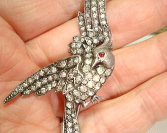 1940s Silver Tone Rhinestone Encrusted Bird of Paradise pin.